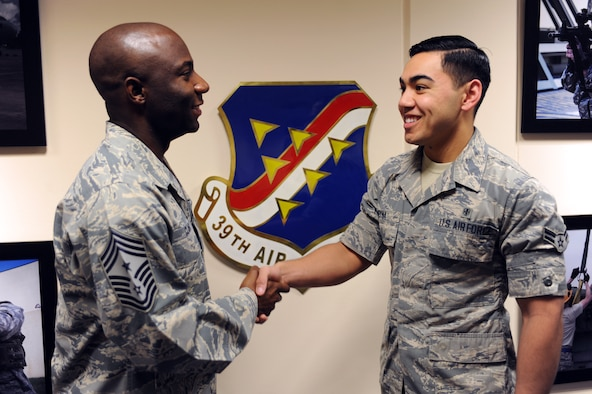 Chief Master Sgt. Vegas Clark, 39th Air Base Wing command chief, greets Airman 1st Class Raul Reyna, 39th Medical Support Squadron medical logistician, before beginning his chief shadow day Nov. 20, 2015. Airmen are chosen for the command chief's shadow program based on their commander's recommendation and their dedication to the mission and their job. (U.S. Air Force photo by Airman 1st Class Daniel Lile/Released)