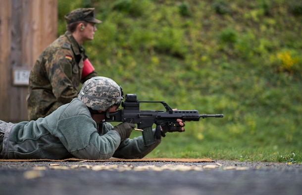 German Army Private 1st Class Dominik Lagershausen, Airborne Infantry Regiment 26, 4th Company Airborne Troop, watches U.S. Air Force Senior Airman Jonathan Ebner, 86th Security Forces Squadron unit fitness program manager, as he fires a G36 assault rifle Nov. 18, 2015, at Zweibruecken, Germany. More than 20 members of the 86th SFS shot German weapons to earn the Bundeswehr (German army) marksmanship badge and build the partnership between the two nations. (U.S. Air Force photo/Senior Airman Damon Kasberg)