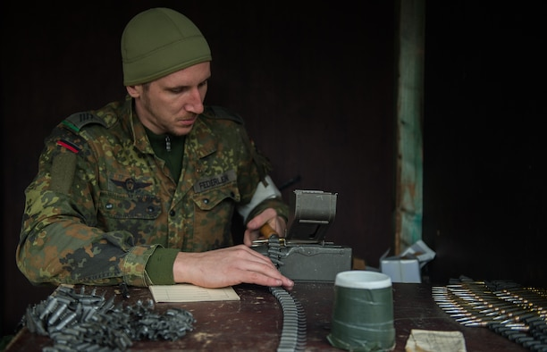 German Army Spc. Deniver Federlein, Airborne Infantry Regiment 26, 4th Company Airborne Troop, reloads ammunition for an MG3 machine gun Nov. 18, 2015, at Zweibruecken, Germany. German Soldiers hosted members of the 86th Security Forces Squadron as they attempted to earn the Bundeswehr (German army) marksmanship badge. (U.S. Air Force photo/Senior Airman Damon Kasberg)