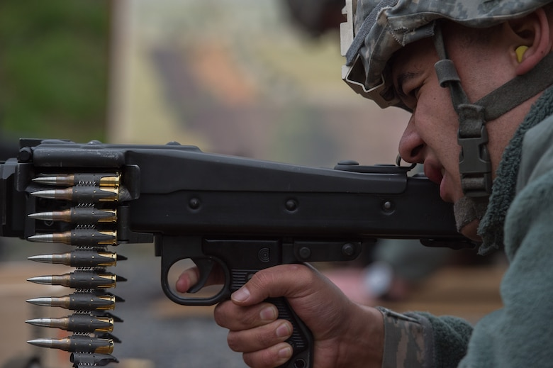 U.S. Air Force Senior Airman Anthony Bruner, 86th Security Forces Squadron member, aims an MG3 machine gun Nov. 18, 2015, at Zweibruecken, Germany. More than 20 members of the 86th SFS attempted to earn the Bundeswehr (German army) marksmanship badge by hitting targets with a variety of German weapons. (U.S. Air Force photo/Senior Airman Damon Kasberg)