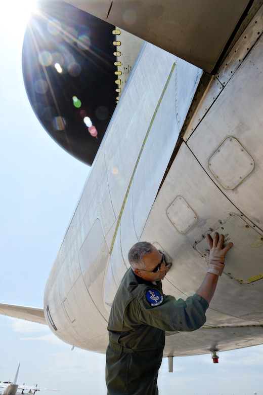 Senior Master Sgt. Tim Brown, an E-3 flight engineer with the 10th Flight Test Squadron, checks the general condition of the AWACS, inside and out, before flights. (Air Force photo by Kelly White/Released)