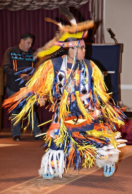 T.J. Tanyan, a northern cloth dancer, performs a traditional grass dance during the Native American Heritage Month luncheon. His sister, Alexis, Miss Indian Oklahoma City, performed a southern cloth dance, Brent Greenwood performed traditional songs with his drum and artist, Jeanne Rorex Bridges was the guest speaker.  (Air Force photo by Kelly White/Released)