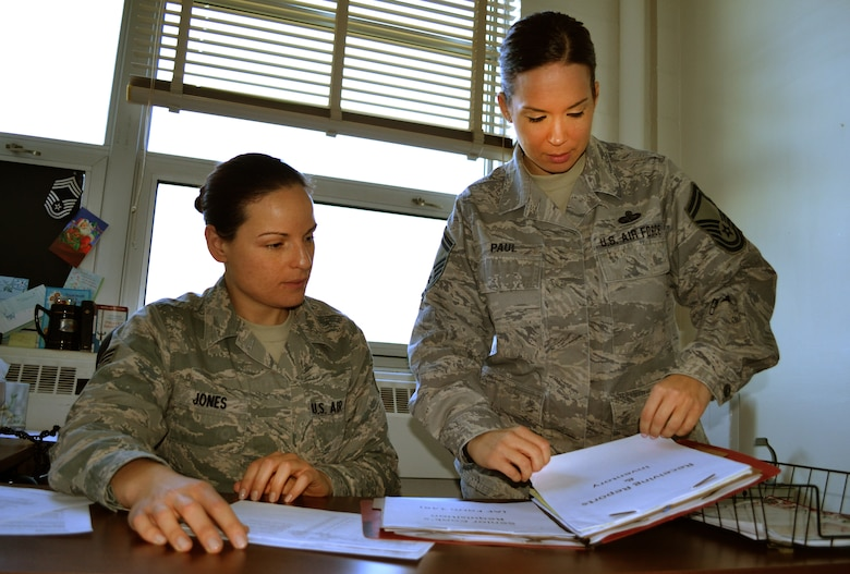 Senior Airman Melissa Jones and Senior Master Sgt. Lauren Paul, both from the 111th Attack Wing Services Flight, review the food order log, Nov. 24, 2015 at Horsham Air Guard Station, Pennsylvania. The services flight is composed of less than 30 members, yet it is responsible for more than 800 Air National Guardsmen, as well as the Army Reserve and Army National Guard during a unit training assembly here. (U.S. Air National Guard photo by Tech. Sgt. Andria Allmond/Released)