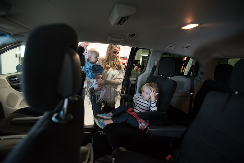 """Amanda Goodlin, wife of the Kentucky Air National Guard's Staff Sgt. Neil Goodlin, inspects the family's new minivan with her son, Dash, and daughter, Ava, at Oxmoor Collision Center in Louisville, Ky., Nov. 20, 2015. The van was donated to the Goodlins as part of the National Auto Body Council's """"Recycled Rides"""" program, which restores wrecked vehicles to like-new condition before giving them to needy individuals. (U.S. Air National Guard photo by Maj. Dale Greer)"""