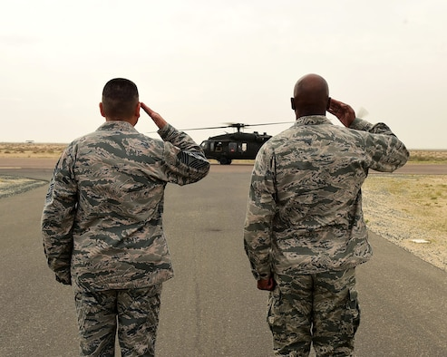 Col. Clarence Lukes Jr., 386th Air Expeditionary Wing commander, and Chief Master Sgt. Richard Vargas, 386th AEW Command Chief Master Sergeant, salute as Central Command commander U.S. Army Gen. Lloyd J. Austin III arrives on the flightline at an undisclosed location in Southwest Asia, Nov. 24, 2015. Austin toured various 386th AEW work centers and interacted with service members expressing gratitude and thanks for their service and support of Operation INHERENT RESOLVE. (U.S. Air Force photo by Staff Sgt. Jerilyn Quintanilla)