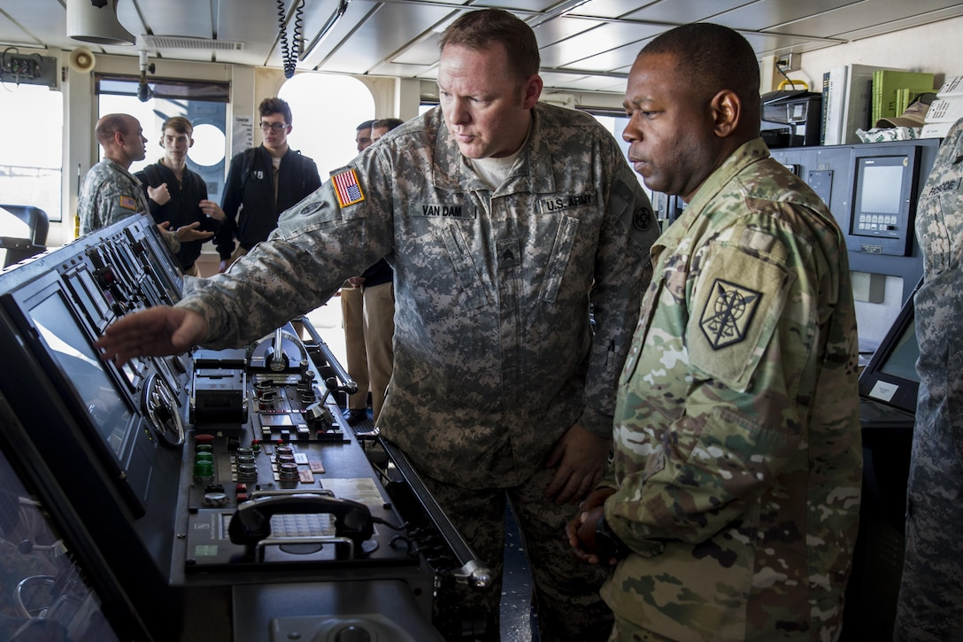 Maj. Gen. Phillip Churn, commanding general of the 200th Military Police Command, receives a tour of the LSV-8 U.S. Army vessel, Maj. Gen. Robert Smalls, from U.S. Army Reserve Sgt. Michael Van Dam, out of the 203rd Transportation Detachment, of Baltimore, during a visit with the U.S. Merchant Marine Academy at Kings Point, N.Y., Nov. 20, in an effort to develop a working relationship to recruit midshipmen into the Army Reserve. The Academy is the only one of five military academies that offers its graduates the option of choosing which branch of service to join after graduation. (U.S. Army photo by Spc. Stephanie Ramirez)