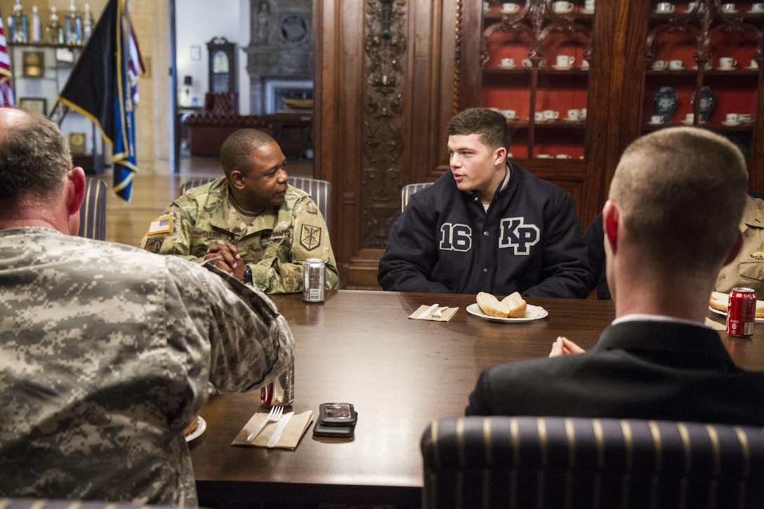 Maj. Gen. Phillip Churn, commanding general of the 200th Military Police Command, has lunch with upper classmen at the U.S. Merchant Marine Academy during a visit at Kings Point, N.Y., Nov. 20, in an effort to develop a working relationship to recruit midshipmen into the Army Reserve. The Academy is the only one of five military academies that offers its graduates the option of choosing which branch of service to join after graduation. (U.S. Army photo by Spc. Stephanie Ramirez)