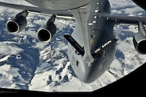 A C-17 Globemaster III from Joint Base Lewis-McChord, Wash., receives fuel from a 92nd Air Refueling Wing KC-135 Stratotanker Nov. 12, 2015, over Washington state. During the flight, honorary commanders were able to lie beside Staff Sgt. Gregory Albers, a 93rd Air Refueling Squadron boom operator, during refueling, as well as view another refueling mission from the cockpit of a different KC-135 and C-17. (U.S. Air Force photo/Airman 1st Class Taylor Bourgeous)