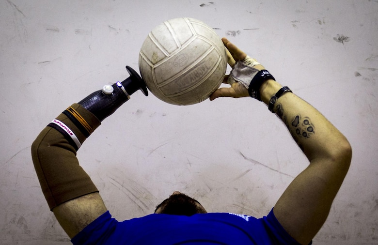 Retired Staff Sgt. Daniel Crane tosses a volleyball while conducting ab exercises during the Air Force-hosted Northeast Regional Warrior Care event at Joint Base Andrews, Md., Nov. 17, 2015. The Air Force Wounded Warrior Program is a federally mandated program that provides personalized care, services and advocacy for wounded, ill and injured service members. Air Force Warrior Care support programs focus on specific personal and family needs through individualized support. (U.S. Air Force photo/Staff Sgt. Marianique Santos)