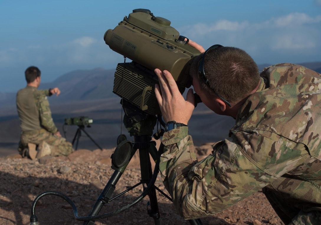 U.S. military personnel assigned to Combined Joint Task Force-Horn of Africa (CJTF-HOA) operate a laser designator during close air support training in Djibouti Nov. 18, 2015. Through unified action with U.S. and international partners in East Africa, CJTF-HOA conducts security force assistance, executes military engagement, provides force protection, and provides military support to regional counter-violent extremist organization operations in order to support aligned regional efforts, ensure regional access and freedom of movement, and protect U.S. interests. (U.S. Air Force photo/Tech. Sgt. Barry Loo)