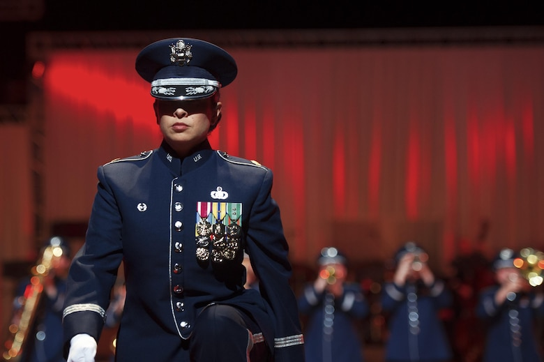 Maj. Cristina Moore Urrutia, the commander and conductor of the U.S. Air Force Band of the Pacific, walks to a podium during the Japan Self-Defense Force Marching Festival at the Nippon Budokan Arena in Tokyo, Japan, Nov. 13, 2015. (U.S. Air Force photo/Airman 1st Class Delano Scott)