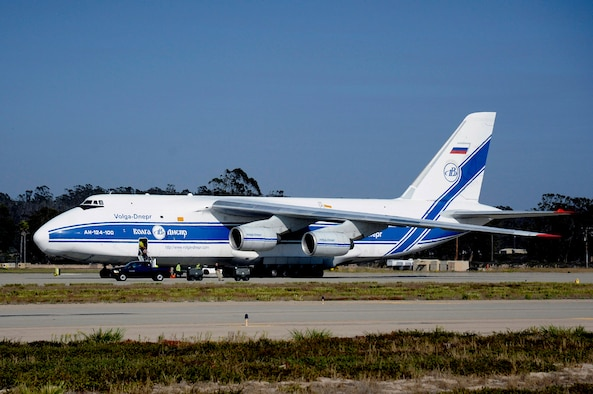 An Antonov AH-124-100 delivers rocket equipment upon its arrival at Vandenberg Air Force Base, Calif., Sept. 9, 2014. A similar aircraft -- the Antonov AN-124, one of the largest cargo aircraft in the world, made its way from a production facility in Huntsville, Ala., to deliver an Atlas V booster here Nov. 20. (U.S. Air Force Photo/Senior Airman Shane Phipps)