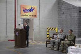 Robert Montefour, site director for Defense Logistics Agency Installation Support at Defense Distribution Susquehanna opens the ribbon ceremony for warehouse 780 on Nov. 16.