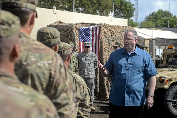 U.S. Deputy Defense Secretary Bob Work discusses Defense Department changes with U.S. soldiers on Camp Lemonnier, Djibouti, Nov. 26, 2015. The soldiers, members of a quick-response unit, are assigned to the Florida Army National Guard's Company D, 2nd Battalion, 124th Infantry Regiment. U.S. Air Force photo by Senior Airman Peter Thompson