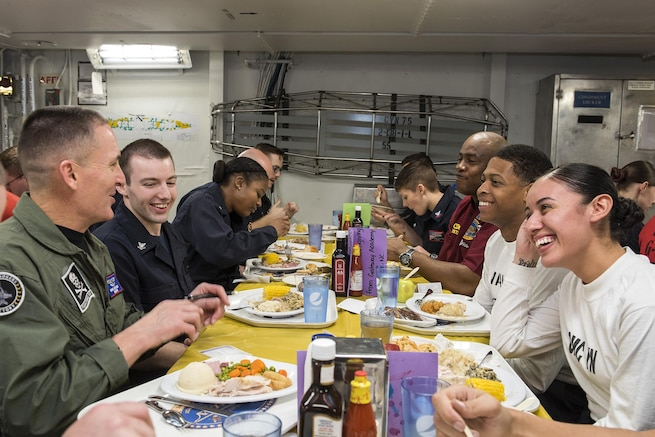 Master Chief Petty Officer of the Navy Michael D. Stevens shares Thanksgiving dinner with sailors on the mess decks aboard the aircraft carrier USS Harry S. Truman in the Atlantic Ocean, Nov. 26, 2015. The Harry S. Truman Carrier Strike Group is supporting maritime security operations and theater security cooperation efforts in the areas of operation for the U.S. 5th and 6th fleets. U.S. Navy photo by Petty Officer 3rd Class A. Cruz