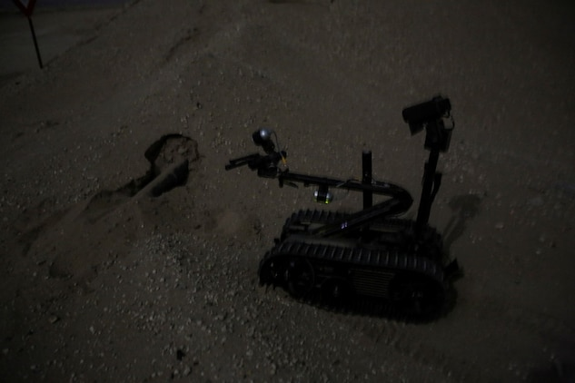 A TALON Mark II robot, operated by U.S. Marine explosive ordnance disposal technicians attached to Special Purpose Marine Air Ground Task Force-Crisis Response-Central Command, approaches a simulated improvised explosive device in the vicinity of a forward operating base during a mission readiness exercise at an undisclosed location in Southwest Asia Nov. 24, 2015. The training exercise consisted of a scenario where a forward operating base in the area of responsibility required SPMAGTF-CR-CC reinforcement as part of its crisis response mission spanning 20 nations in the U.S. Central Command area of responsibility.  (U.S. Marine Corps Photo by Sgt. Rick Hurtado / Released)
