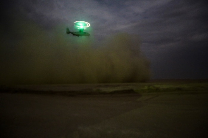 A U.S. Marine Corps MV-22 Osprey takes off after transporting U.S. Marines with Company C, 1st Battalion, 7th Marine Regiment, Special Purpose Marine Air Ground Task Force-Crisis Response-Central Command, at an undisclosed location in Southwest Asia during a mission readiness exercise Nov. 23, 2015.  The training exercise consisted of a scenario where a forward operating base in the area of responsibility required SPMAGTF-CR-CC reinforcement as part of its crisis response mission spanning 20 nations in the U.S. Central Command area of responsibility. (U.S. Marine Corps Photo by Sgt. Rick Hurtado / Released)