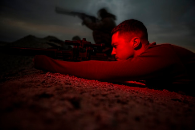 U.S. Marine Cpl. Taylor Giffard, a ground signals operator with Special Purpose Marine Air Ground Task Force-Crisis Response-Central Command, acts as an opposition force during a mission readiness exercise for 1st Battalion, 7th Marine Regiment, at an undisclosed location in Southwest Asia, Nov. 24, 2015. Giffard probed the Marine forward operating base and simulated enemy tactics to give the Marines a realistic look at possible scenarios during the exercise.  SPMAGTF-CR-CC is currently deployed with a crisis response mission spanning 20 nations in the U.S. Central Command area of responsibility. (U.S. Marine Corps Photo by Sgt. Owen Kimbrel / Released)