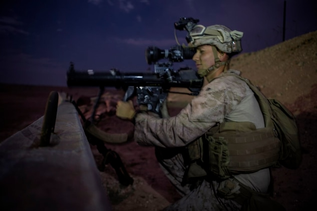 U.S. Marine Cpl. Christian Reyes, a shoulder-launched multipurpose assault weapon gunner with 1st Battalion, 7th Marine Regiment, Special Purpose Marine Air Ground Task Force-Crisis Response-Central Command, scans the surrounding environment for possible threats during a mission readiness exercise at an undisclosed location in Southwest Asia, Nov. 24, 2015. The Marines conducted the exercise to prepare for potential missions in the Central Command area of responsibility.  (U.S. Marine Corps Photo by Sgt. Owen Kimbrel / Released)