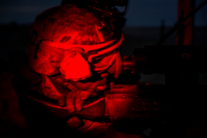 U.S. Marine Lance Cpl. Terence Clayborne, a rifleman with 1st Battalion, 7th Marine Regiment, Special Purpose Marine Air Ground Task Force-Crisis Response-Central Command, searches from his post for possible threats during a mission readiness exercise at an undisclosed location Nov. 24, 2015. Clayborne reported various threats and anomalies during the exercise to hone his skills for potential missions in the Central Command area of responsibility. (U.S. Marine Corps Photo by Sgt. Owen Kimbrel / Released)
