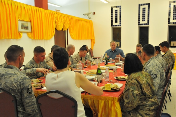 Deputy Secretary of Defense Bob Work talks with service members during a Thanksgiving meal at Al Udeid Air Base, Qatar. There were 14 service members who ate with the Honorable Mr. Work and his wife Mrs. Cassandra Work. The Deputy Secretary of Defense started off with introductions but quickly got to the important stuff; thanking the service members and eating turkey and stuffing. (U.S. Air Force Photo by Tech. Sgt. Terrica Y. Jones)