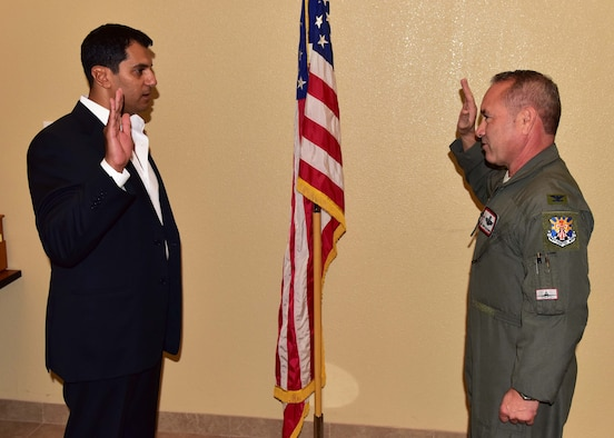 Dr. John Beshai, Arizona Mayo Clinic cardiologist and senior associate consultant, raises his right hand while Col. Kurt Gallegos, 944th Fighter Wing commander, tenders the Oath of Office during a short ceremony and welcomed Beshai to the unit Oct. 24, at Luke Air Force Base, Ariz. (U.S. Air Force photo taken by Tech. Sgt. Louis Vega Jr.)