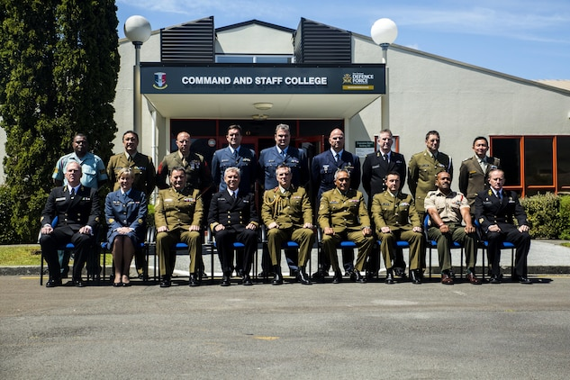Lt. Gen. Tim Keating, center, takes a photo with the graduating class of the Defence Force Command and Staff College, Wellington, New Zealand, Nov. 19, 2015. Sgt. Maj. Christian L. Charkowski, in the second row, third from left, was the first U.S. Marine and second U.S. service member to graduate from the course. He attended the Joint Warrant Officers' Advanced Course, where the objectives were to prepare senior level leaders for senior strategic advisory positions, increase the students' knowledge of regional security for the Pacific Southwest, and provide insight into the workings of the government. Charkowski, from Madison, Wisconsin, is the battalion sergeant major for 3rd Combat Assault Battalion, 3rd Marine Division, III Marine Expeditionary Force. Keating is the chief of defence for the New Zealand Defence Force. (Marine Corps. photo by Cpl. Tyler S. Giguere/Released)