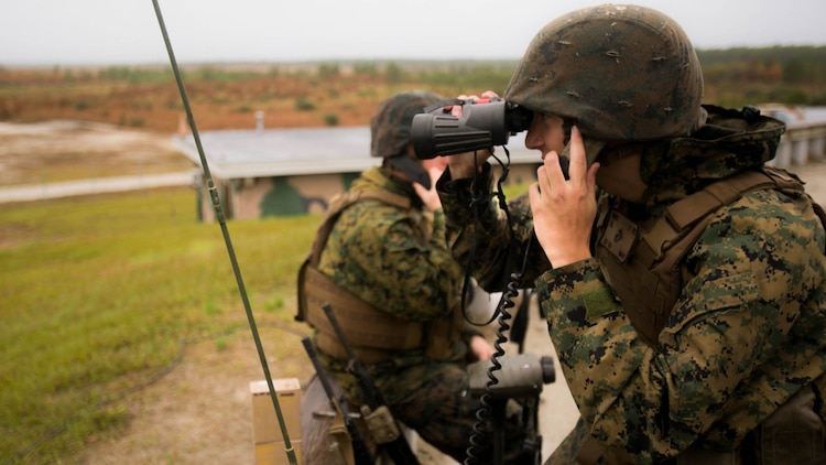 Cpl. Darion Binder,a fire supportman with 1st Battalion, 10th Marine Regiment radios in during a live-fire training event at Camp Lejeune, N.C., Nov. 19, 2015. The Marines conducted this training in order to test the new M1122 training round.