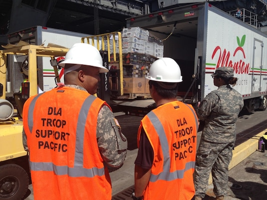 DLA Troop Support Pacific personnel oversee the delivery of fresh fruit and vegetables to the USS Theodore Roosevelt Nov. 15 at Joint Base Pearl Harbor Hickam, Hawaii. It was the first delivery through Troop Support Pacific's new long-term FF&V contract.
