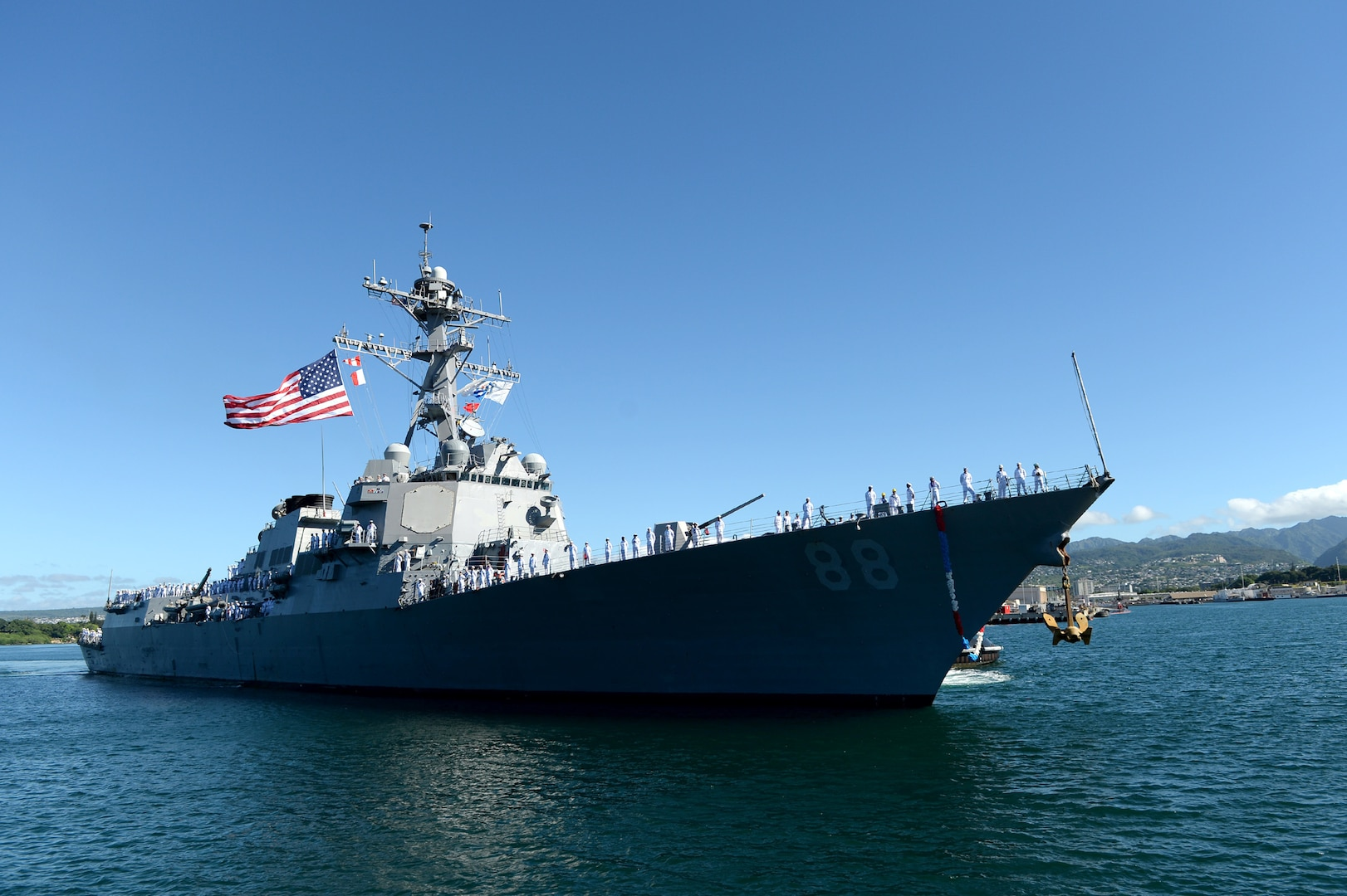In this photo, the guided-missile destroyer USS Preble (DDG 88) prepares to moor at Joint Base Pearl Harbor-Hickam following an independent deployment to the Western Pacific. Deployed since March, the crew of more than 300 Sailors steamed a total of 48,550 nautical miles across the U.S. 3rd and 7th Fleet areas of operation. While deployed Preble conducted various theater security operations and goodwill activities with partner nations.