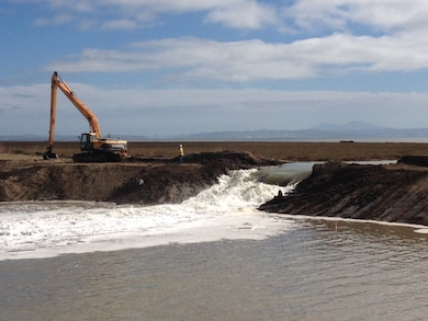 A levee at Sears Point in Sonoma County, Calif., is breached as part of a project to restore wetlands and protect the San Francisco Bay Area against anticipated sea level rise. The largest private environmental project in the Bay Area was authorized by the U.S. Army Corps of Engineers San Francisco District under terms of the Clean Water Act.