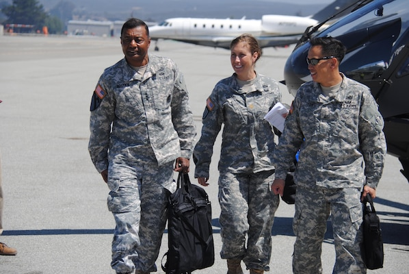 Lt. Gen. Thomas P. Bostick, left, commanding general and chief of engineers, U.S. Army Corps of Engineers, arrives at Monterey Airport prior to taking a tour of the Presidio of Monterey, one of several projects he visited while in the San Francisco Bay Area.
