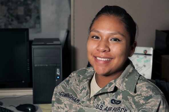 U.S. Air Force Senior Airman Letyraial Cunningham, a 19th Civil Engineer Squadron engineering apprentice, poses for a photo Nov. 18, 2015, at Little Rock Air Force Base, Ark. Cunningham, a Navajo Native American grew up in Cortez, Colo. She continues to practice her traditions while she is stationed at Little Rock AFB. (U.S. Air Force photo by Airman 1st Class Mercedes Muro)