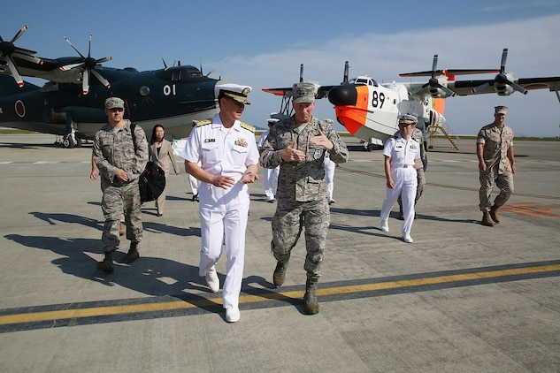 U.S. Air Force Lt. Gen. John L. Dolan, commander of U.S. Forces Japan and 5th Air Force, right, and Rear Adm. Naoki Sonoda, commander of Japan Maritime Self-Defense Force, Fleet Air Wing 31, left, say their goodbyes at the Japan Maritime Self-Defense Force hangar, Marine Corps Air Station Iwakuni, Japan, Sept. 29, 2015. Dolan set aside time during his brief stop at the station to reconnect with the JMSDF service members who rescued him after an aircraft collision almost two decades ago. Dolan ejected from his F-16, 630 nautical miles away from Tokyo into the Pacific Ocean, where he was saved almost five hours later by the Japanese aircraft rescue crew.