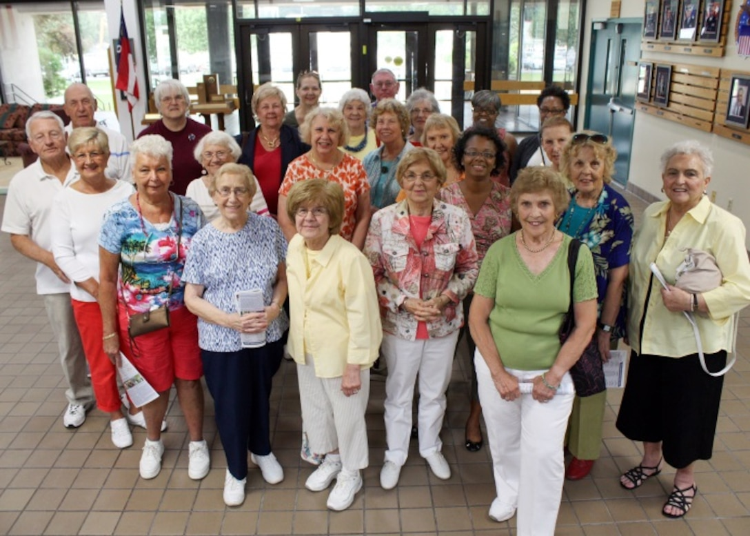 The Depot Women's Club members and friends, a club in existence since 1963, pause for a group shot after visiting DLA Distribution Susquehanna, Pa. to discuss the history and mission of both their club and the Defense Distribution Center Susquehanna installation.