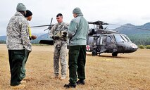 """Col. Andrew Gainey and Command Sgt. Maj. Freddie Barbary, command team, 17th Field Artillery Brigade, 7th Infantry Division, visit Soldiers of the 2nd GSAB, 1st Avn. Regt., 1st CAB, 1st Inf. Div.  The """"Big Red One"""" Soldiers are providing around-the-clock medevac training and support to civilian and military agencies fighting the massive wildfire in northeastern Washington state.  """"The 1st Inf. Div. and Fort Riley are once again on point for our nation,"""" said Maj. Gen. Wayne W. Grigsby Jr., commanding general of the 1st Inf. Div. and Fort Riley.  """"Fort Riley's central location in Kansas is key to the 'Big Red One's' ability to provide ready Soldiers to support operations on either coast or around the world.  Our brave and responsible Big Red One Soldiers are proud to support this interagency effort – they can and will accomplish any mission set in front of them.""""  On Aug. 17, the National Interagency Fire Center in Boise, Idaho, mobilized active-duty Soldiers to serve as firefighters to assist with wildfire suppression efforts, according to information from NORTHCOM.  This is the first time since 2006 the NIFC has called upon active-duty Soldiers to assist in firefighting efforts."""