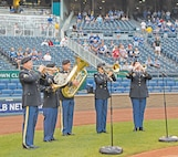 "Members of the 1st Infantry Division Band play ""America the Beautiful"" during the pre-game ceremony Sept. 7 at Kauffman Stadium in Kansas City, Missouri. Soldiers of the ""Big Red One"" and Fort Riley were at the evening game between the Kansas City Royals and Minnesota Twins to take part in Armed Forces Night. Soldiers from Division Headquarters and Headquarters Battalion, 1st Armored Brigade Combat Team, 2nd Armored Brigade Combat Team, 1st Combat Aviation Brigade, Irwin Army Community Hospital and the 97th Military Police Battalion were invited on the field where they participated in reenlistment and awards ceremonies and helped announce the Royals' starting lineup. Maj. Gen. Wayne W. Grigsby Jr., 1st Inf. Div. and Fort Riley commanding general, accepted a game ball from Ned Yost, the Royals' head coach."