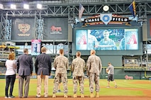 Staff Sgt. Zachery Kipp, Company D, 1st Attack Helicopter Battalion, 1st Aviation Regiment, 1st Combat Aviation Brigade, 1st Infantry Division, is recognized Aug. 25 during an Arizona Diamondbacks baseball game at Chase Field in Phoenix. Kipp was in Arizona to receive the 2015 Bob Wylie Award for Apache Maintenance Excellence at the Boeing Production Facility in Mesa, on Aug. 26. The award recognizes Soldiers for excellence in contributing to an Apache unit's maintenance mission, demonstrating respect for his or her fellow Soldiers and making a positive impact to the people they work with and for, according to information from the Apache program manager's office.