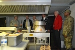 A group of Subsistence employees tour a field kitchen Sept. 24 that was set up by a Pennsylvania National Guard unit staged at NSA Philadelphia in support of the Papal visit and World Meeting of Families.