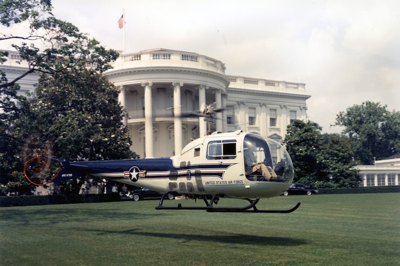 The UH-13J provided the president with quick and convenient air travel directly to and from the White House. The aircraft on display is shown landing on the West Lawn in 1957. (U.S. Air Force photo)