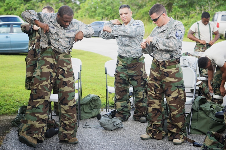 Airmen assigned to the 36th Wing don mission oriented protective posture gear during chemical, biological, radiological and nuclear training Oct. 1, 2015, at Andersen AFB, Guam. Emergency managers teach a CBRN refresher course once a month to Airmen who are preparing for a permanent change of station or deploying to medium or high-threat level duty stations. (U.S. Air Force photo by Senior Airman Joshua Smoot/Released)