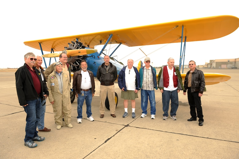 Lt. Col. Andrew McVicker (center), 9th Operations Group deputy commander, and volunteers from the Aerospace Museum of California, pose in front of McVicker's P-13 Stearman at McClellan Airfield, California, Sept. 30, 2015.  The volunteers watched over McVickers plane while he was deployed and to show his gratitude he took the volunteers on a flight in his P-13 Stearman. (U.S. Air Force photo by Airman 1st Class Jessica B. Nelson)