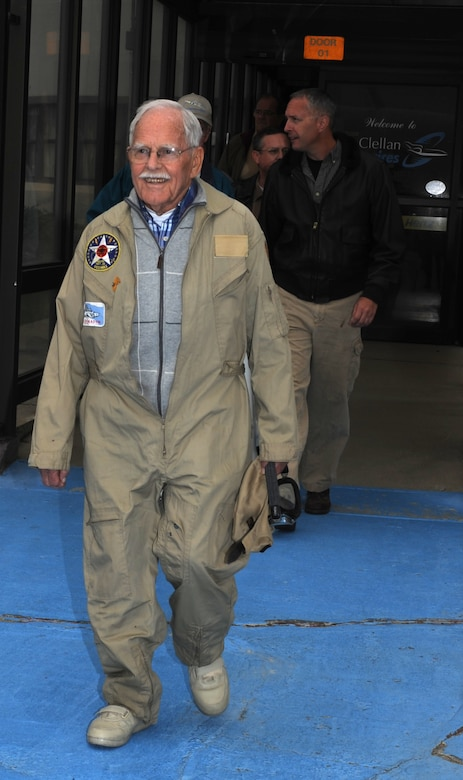 Maynard Nelson, a WWII veteran, walks out to the flightline at McClellan Airfield, California, Sept. 30, 2015.  Nelson is a volunteer at the Aerospace Museum of California, where he watched over a P-13 Stearman while the owner was deployed. (U.S. Air Force photo by Airman 1st Class Jessica B. Nelson)