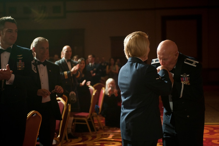 Retired Col. George Peterson greets Airman Brenna Albright during the 2015 Las Vegas Air Force Ball at the South Point Hotel and Casino in Las Vegas, Sept. 26, 2015. Peterson and Albright were the oldest and youngest past or present uniformed Airman in attendance. (U.S. Air Force photo by Staff Sgt. Siuta B. Ika)