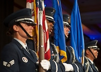 Members of the Nellis Air Force Base Honor Guard prepare to retire the colors during the 2015 Las Vegas Air Force Ball at the South Point Hotel and Casino in Las Vegas, Sept. 26, 2015. In addition to presenting and retiring the colors, the Honor Guardsmen performed a Missing Man Table and Honors ceremony to pay respects to members of the U.S. armed forces who are/were prisoners of war or missing in action. (U.S. Air Force photo by Staff Sgt. Siuta B. Ika)