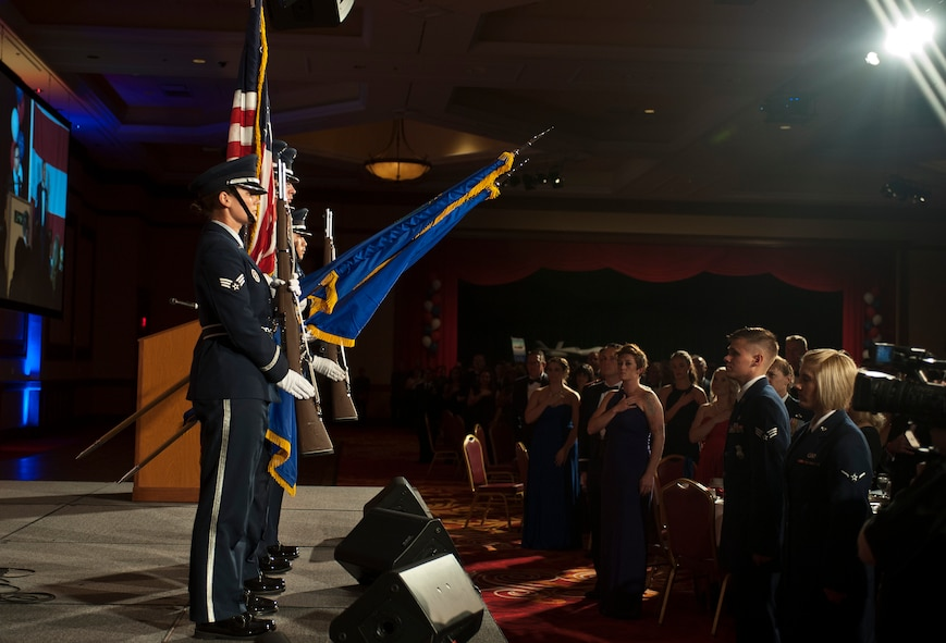 """Members of the Nellis Air Force Base Honor Guard present the colors during the 2015 Las Vegas Air Force Ball at the South Point Hotel and Casino in Las Vegas, Sept. 26, 2015. The theme for this year's event was, """"Embracing our Legacy, Forging the Future"""" and recognized Air Force Airmen and their families serving worldwide. (U.S. Air Force photo by Staff Sgt. Siuta B. Ika)"""