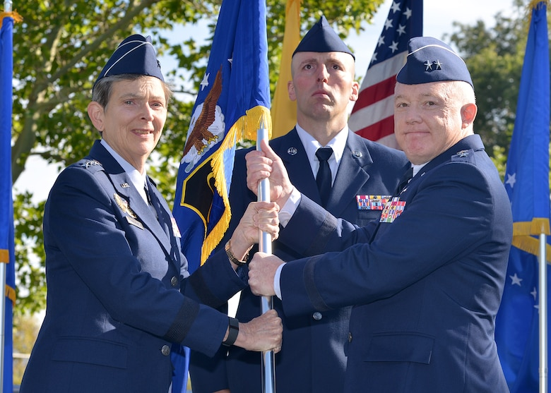 Maj. Gen. Scott Jansson, right, takes the Air Force Nuclear Weapons Center guidon from Gen. Ellen Pawlikowski, Air Force Materiel Command, during a change of command ceremony Oct. 1 at Hardin Field. Jansson is the new AFNWC commander. (Photo by Todd Berenger)