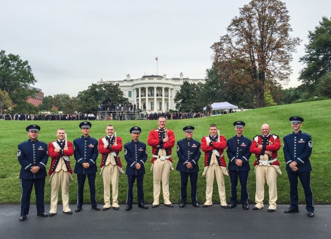 Percussionists from The United States Air Force Band and The United States Army Old Guard Fife and Drum Corps pose on the White House lawn prior to the arrival ceremony of Chinese President Xi Jinping. (U.S. Air Force photo/released)