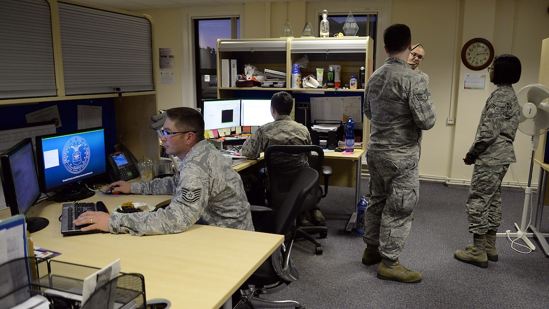U.S. Air Force Airmen from the 100th Comptroller Squadron work diligently Sept. 30, 2015 on RAF Mildenhall, England. The 100th CPTS financial services team scanned through approximately 3,000 overseas housing allowance documents as part of a Secretary of the Air Force - directed audit. Airmen went through documents – each of which takes about 10 minutes to pull up and examine – for any utilities that may be included, but should not be in OHA. (U.S. Air Force photo by Senior Airman Christine Halan/Released)
