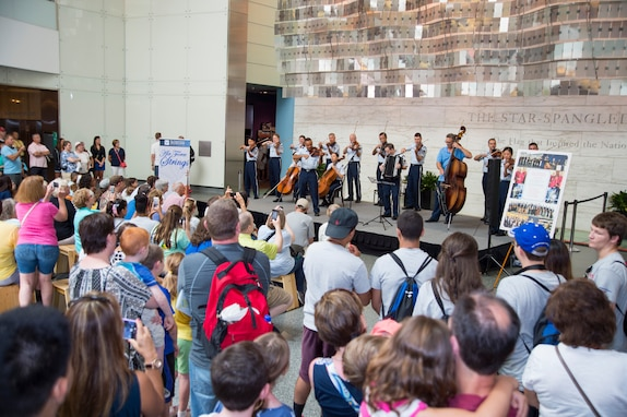 An audience gathers to listen to the U.S. Air Force Band's Strolling Strings at the National Museum of American Histroy in Washginton, D.C., July 16, 2015. The Strolling Strings performance was part of the museum's Star-Spangled American Music Series. (U.S. Air Force photo/Airman 1st Class Ryan J. Sonnier).